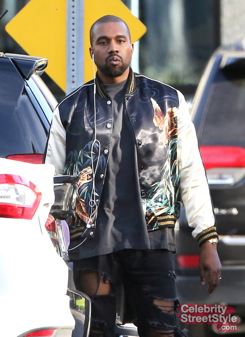 Kanye West leaves the studio wearing a jungle print jacket and extremely ripped black jeans in Los Angeles, CA. West takes a walk with a friend and then appears to be enthralled in cell phone conversation, flashing his grill. Monday, February 22, 2016. X17online.com
