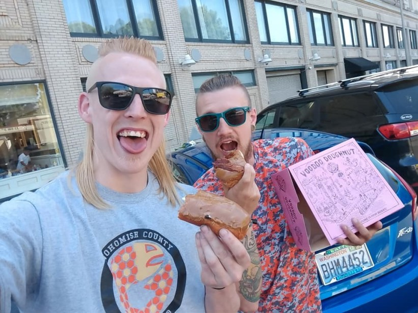 Steven Moseley and Tanner Edenholm with Voodoo Donuts.
