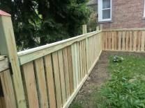 Eastside of fence looking at neighbors house (pine tree faces the street)
