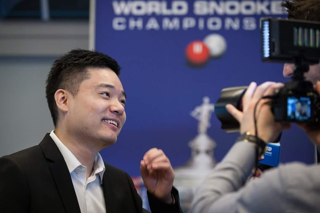 Favourite Ding reaches World Snooker Championships quarter-final