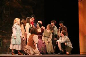 Cherlynn Alvarez (center) and children's ensemble Insight Theatre Company