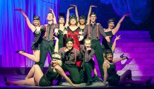 Lindsey Jones (center) and Ensemble Photo by John Lamb Stray Dog Theatre