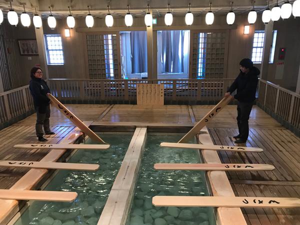 Cooling onsen water with paddles at Kusatsu