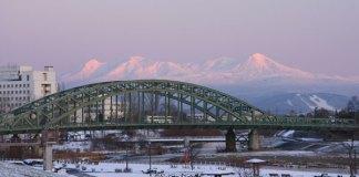 Hokkaido's highest mountains tower behind Asahikawa
