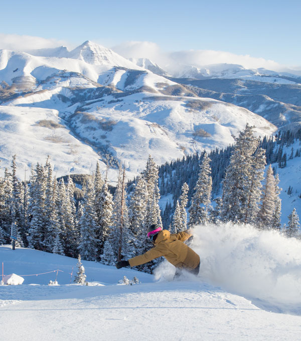 Snowboarding steep powder Crested Butte