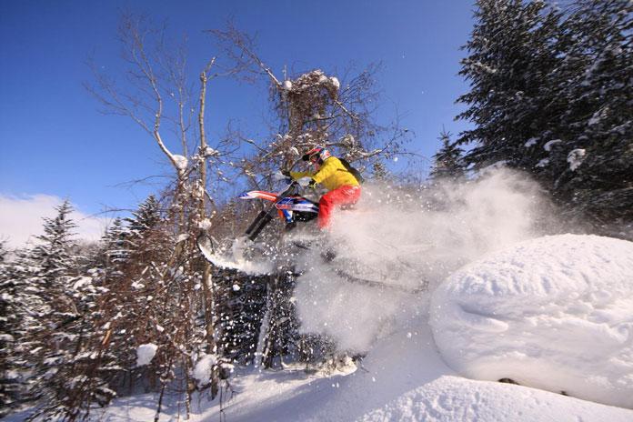 snow bike hokkaido jumping off big snow feature