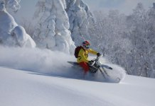 Slashing deep powder with Hokkaido Snow Bikes
