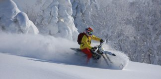 Slashing deep powder with Hokkaido Snow Bikes