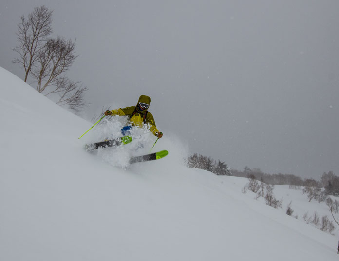 Hachimantai Cat Skiing guide Junya Kuragane charging hard in the powder snow on Mt Chausu