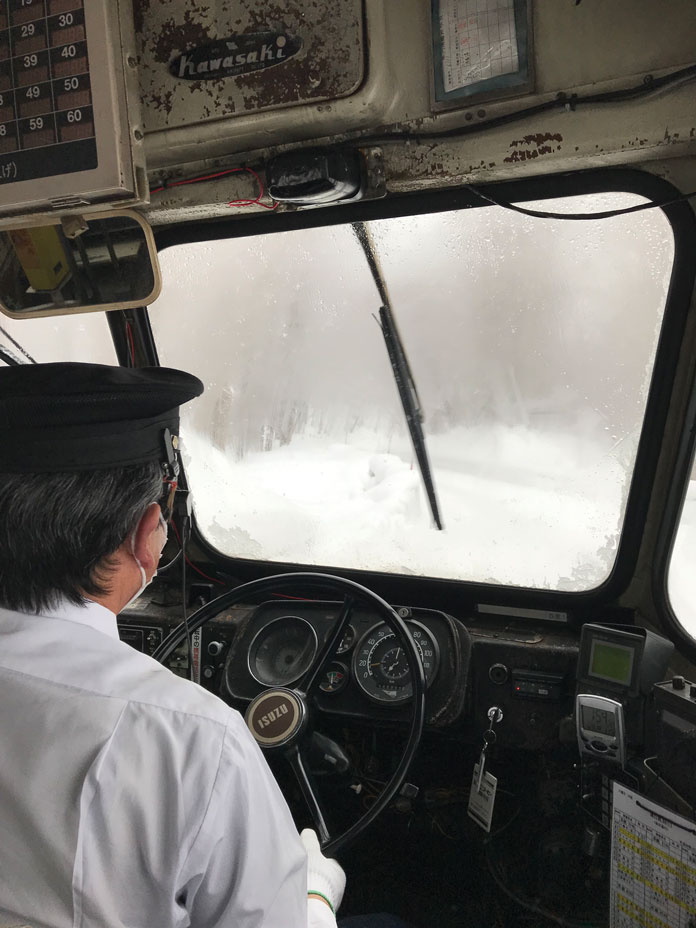 Driver's view inside the cabin of the Bonnet Bus to Matsukawa Onsen, Hachimantai