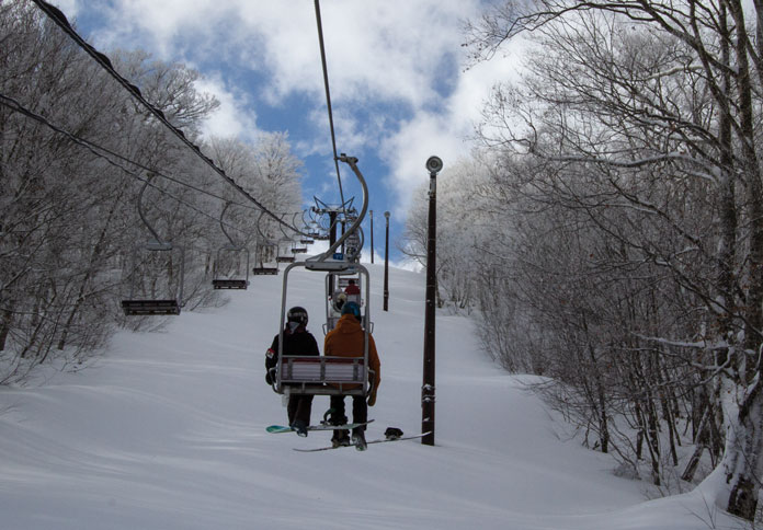 Lonely riding chairlift at Nekoma