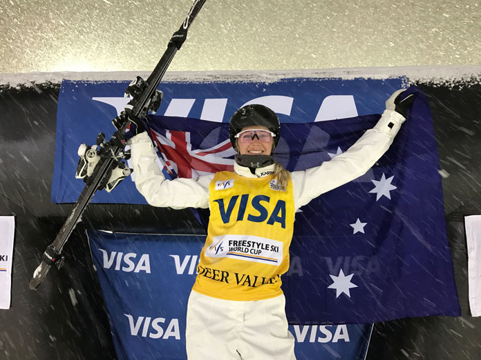 Danielle Scott celebrates on podium at World Cupp Deer Valley