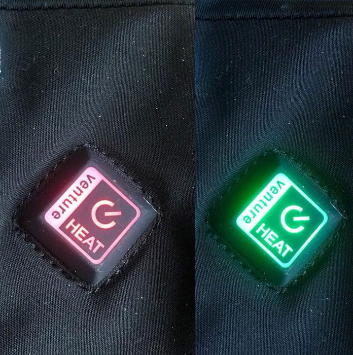 Heat setting button on Venture Heat Avert glove liners glows red or green according to the setting