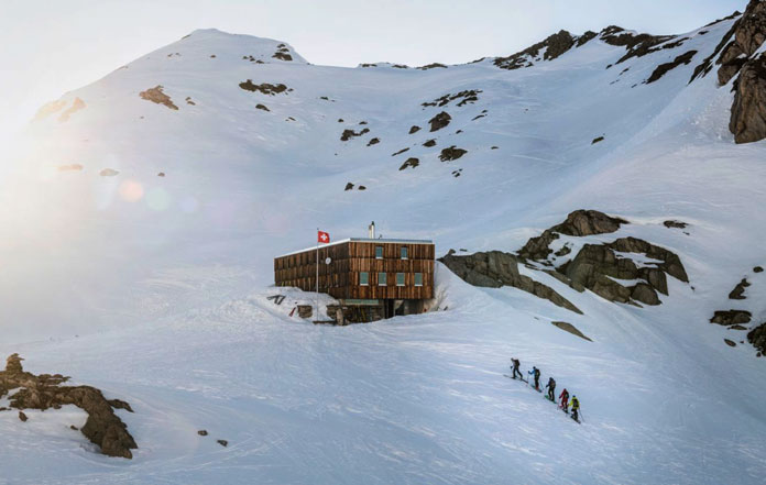 Arriving at Cristallina Hut on Swiss Ski Tour from Andermatt to Locarno