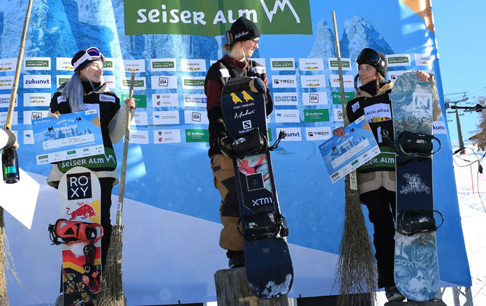 Tess Coady on top of podium at Seiser Alm Slopestyle World Cup