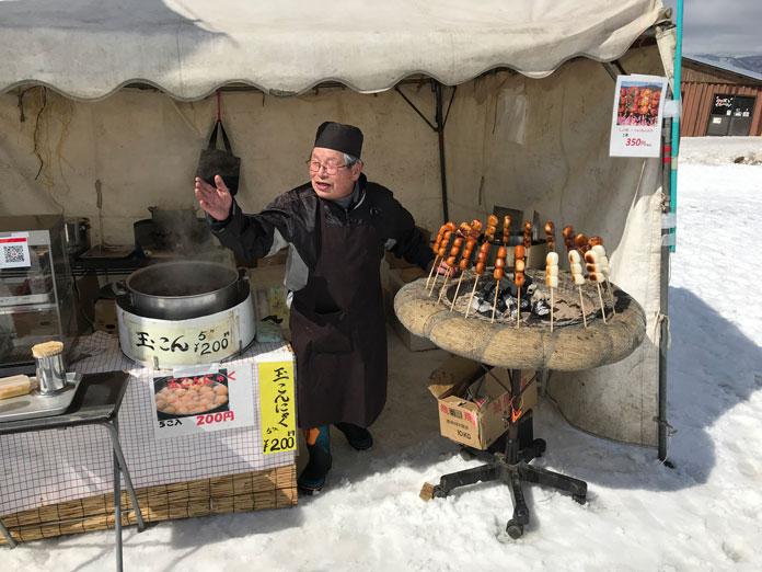 Barbecued rice balls and miso paste stall at Numajiri ski area, Aizu