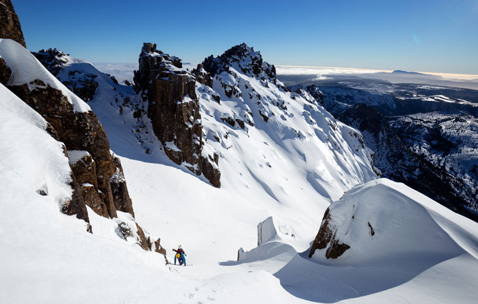 Climbing up for another ski lap of the spectacular East Face bowls of Cradle Mountain