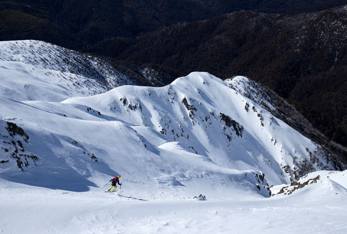 Skier dropping into Headwall at Mt Feathertop