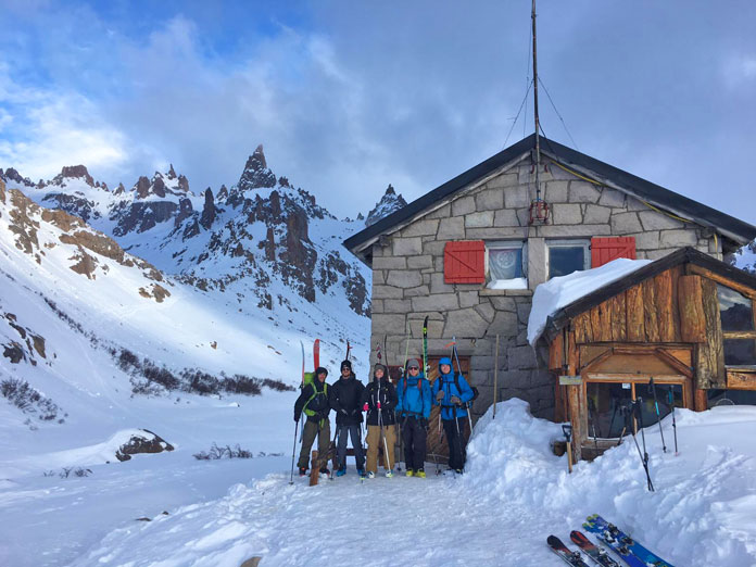 Group of skiers head out from Refugio Frey