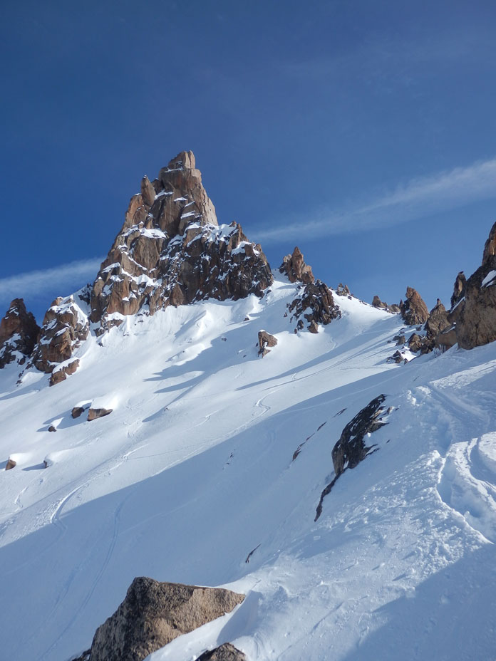 Ski tracks below main spire of Catedral above Refugio Frey