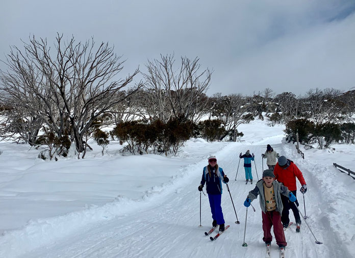 Family go for a cross country ski at Perisher