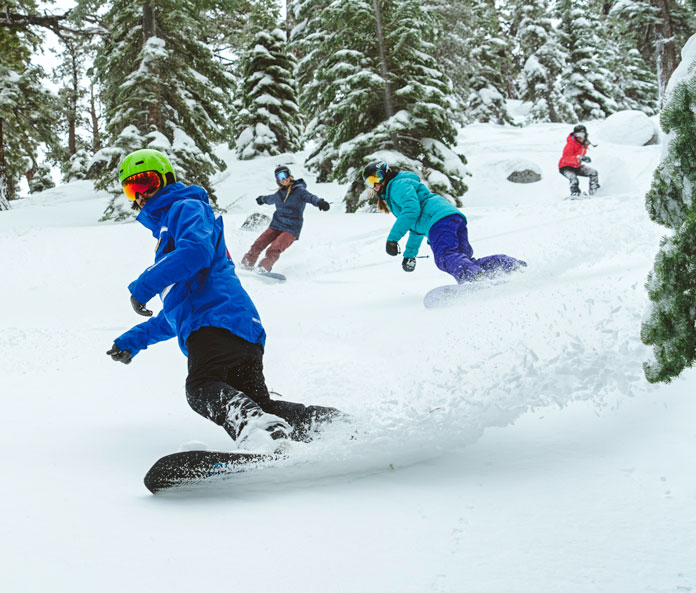 Snowboard class riding the glades at Heavenly Ski Resort