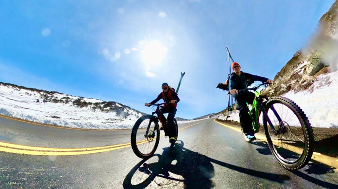 Mountain biking up the Charlotte Pass road to go back country skiing