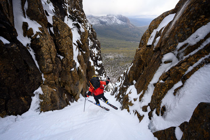 Skiing the super stepp Sisyphus Chute on the Du Cane Range, Tasmania