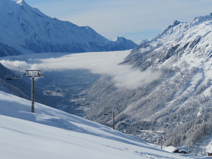 Powder snow under closed quad chairlift at Chamonix in January 2021