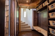 The skier-friendly entryway has personal cubbies and a convenient bench [Tamarack]