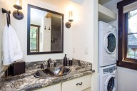 The main level full bath, with a shower, washer and dryer, serves as the master bath as well as the powder room [Ponderosa]