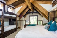 The loft bedroom sleeps 4 in a cozy king bed and 2 twin bunkbeds [Ponderosa]