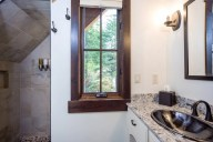 The loft level bath includes a shower and an extra wide vanity [Ponderosa]