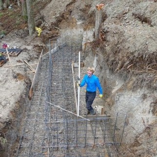 Ben setting the rebar for the foundation of the pull outs