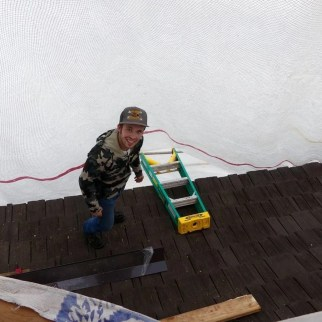 Henry working on the roof