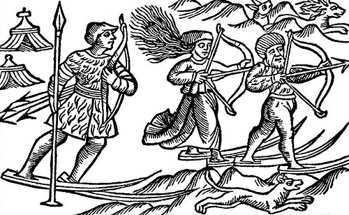 """This picture shows two Sami (Lap) men and a woman hunting on skis. Illustration is from a book by Olaus Magnus """"Historia de Gentibus Septentrionalibus"""" (History of the Nordic Peoples), published in Rome 1555."""