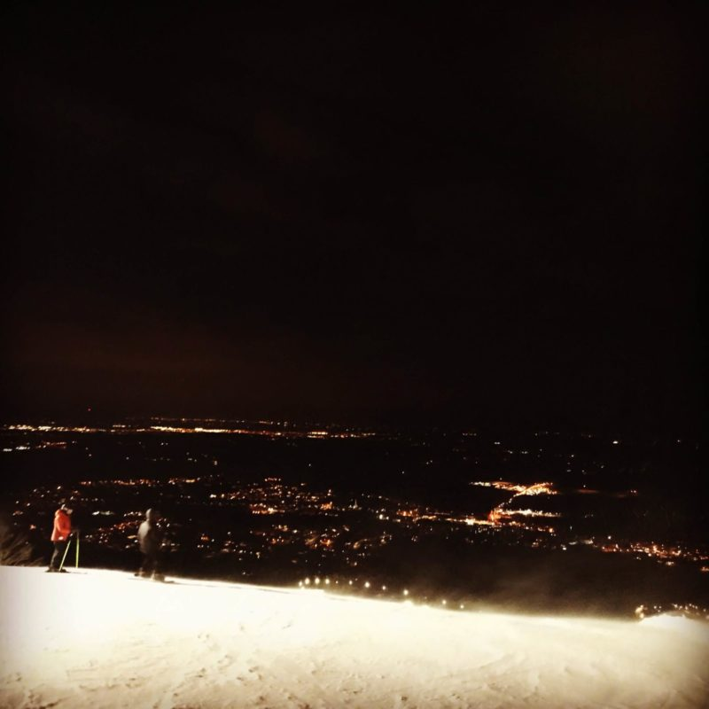 Riding above the city lights