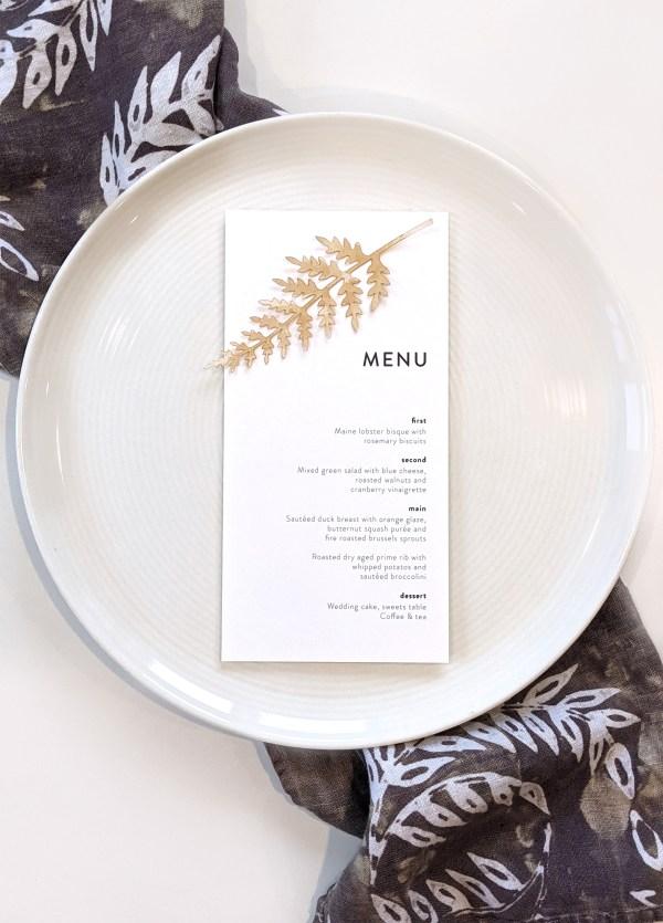 wedding menu with tea stained fern leaf