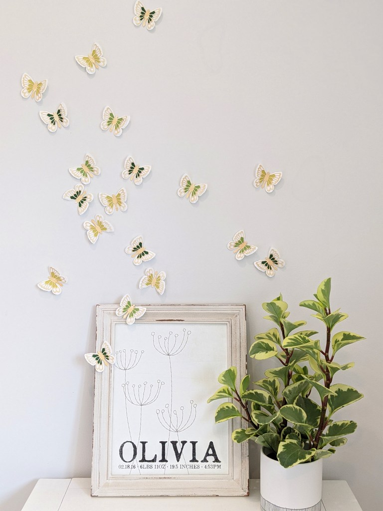 Tea stained butterflies, green set on wall with picture frame and plant