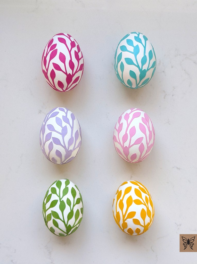 Decorated Easter Eggs with colorful leaf wraps