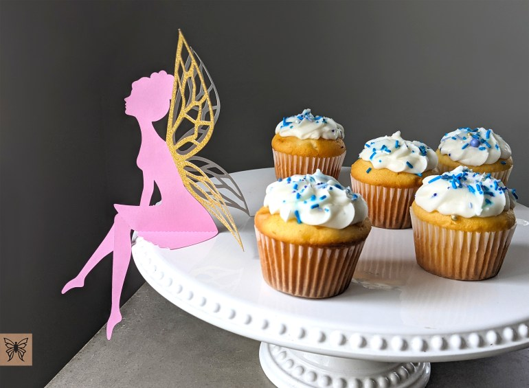 Fairy party decoration at dessert table with cupcakes