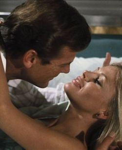 Roger Moore showing Britt Ekland his appreciation in The Man With The Golden Gun (1974)