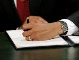 President Barack Obama signing legislation, the 7th left-handed US President.