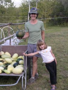 Georgie with daughter Gigi during winter squash harvest in 2009