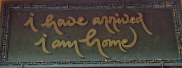 "A sign showing the words ""I have arrived, I am home"" in the calligraphy of Thich Nhat Hanh."
