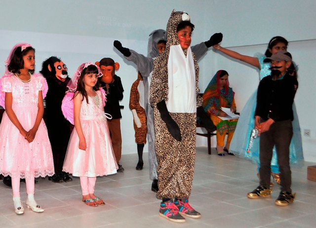 The snow leopard took center stage in a kids' play about the damage of poaching.