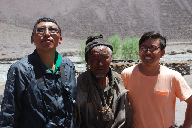 Karma Sonam, Stanzin Namgail, and a Ladakhi herder they've helped build a corral