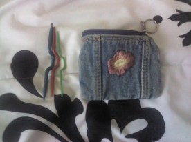 This is a coin pouch from an old purse that I now use to hold my cable needles.