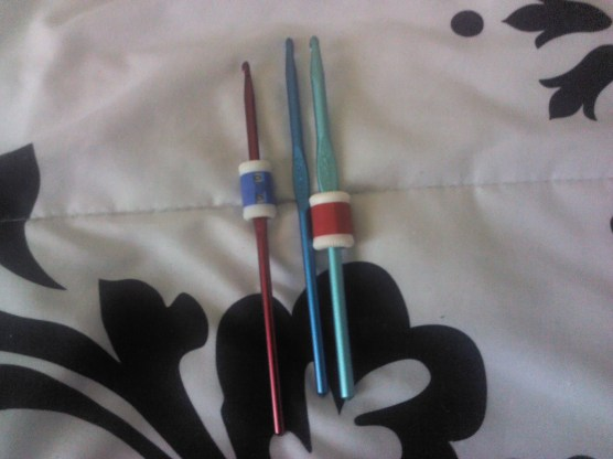 Crochet hooks, two with row counters on them.