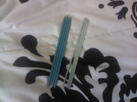 Two sets of double pointed needles.